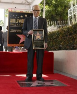 Italian composer Ennio Morricone poses on his star after it was unveiled on the Hollywood Walk of Fame in Hollywood, California February 26, 2016. REUTERS/Mario Anzuoni